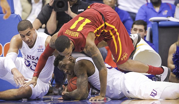 Iowa State guard Monte Morris (11) falls on top of Kansas forward Jamari Traylor (31) as Traylor slides to secure a loose ball during the second half, Saturday, March 5, 2016 at Allen Fieldhouse. At left is Kansas forward Landen Lucas (33).