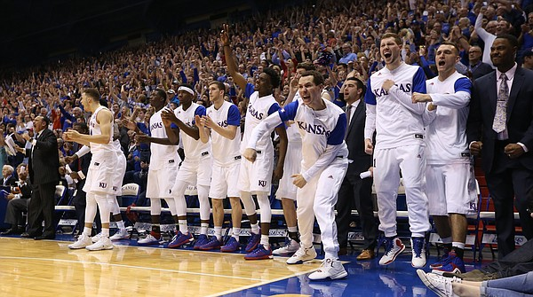 The Kansas bench explodes after a late bucket by Devonte' Graham during the second half on Saturday, March 5, 2016 at Allen Fieldhouse.