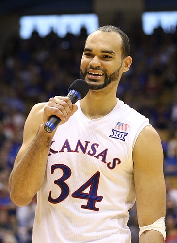 Kansas forward Perry Ellis (34) jokes with the coaching staff during the Senior Day speeches following the JayhawksÕ 85-78 win over the Cyclones