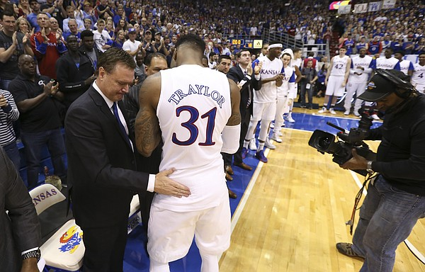 Kansas head coach Bill Self gives a pat to Kansas forward Jamari Traylor (31) after Traylor gave an emotional Senior Day speech following the JayhawksÕ 85-78 win over the Cyclones.