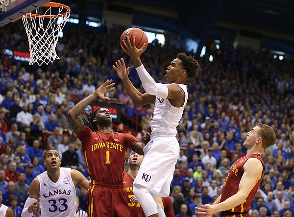Kansas guard Devonte' Graham (4) gets in the paint for a shot before Iowa State forward Jameel McKay (1) during the first half on Saturday, March 5, 2016 at Allen Fieldhouse.