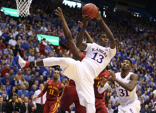 Kansas forward Cheick Diallo (13) pulls down an offensive rebound during the first half on Saturday, March 5, 2016 at Allen Fieldhouse.
