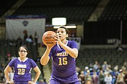 Haskell Indian Nations University basketball player Keli Warrior (15) shoots free throws during Wednesday's NAIA tournament game against Dakota Wesleyan at the Tyson Events Center in Sioux City, Iowa.
