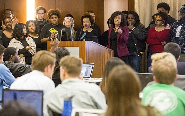 Jameelah Jones, center, and Katherine Rainey, right, speak to the Kansas University Student Senate about a proposed Multicultural Student Government fee during the Student Senate meeting Wednesday evening March 9, 2016, at the Kansas Union.