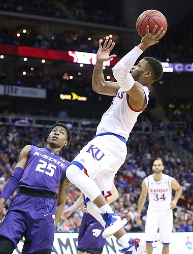 Kansas guard Frank Mason III (0) pulls up for a shot against Kansas State forward Wesley Iwundu (25) during the first half, Thursday, March 10, 2016 at Sprint Center in Kansas City, Mo.