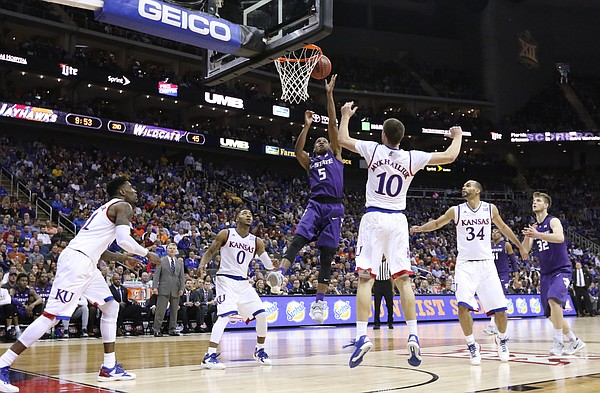 Kansas State guard Barry Brown (5) gets to the bucket against the Jayhawks during the second half, Thursday, March 10, 2016 at Sprint Center in Kansas City, Mo.