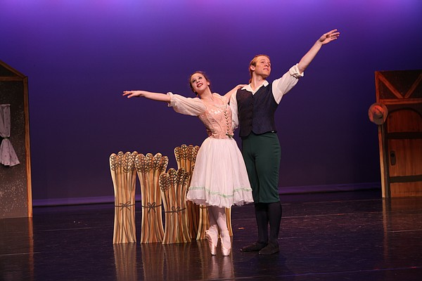 "Young dancers rehearse a scene from ""La Fille Mal Gardee"" Thursday, March 11, at the Lawrence Arts Center, 940 New Hampshire St. The classical comedy ballet will be performed Friday and Saturday at the Arts Center as part of a double feature with ""Carnival of the Animals."""