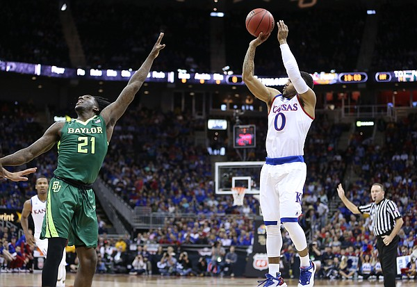 Kansas guard Frank Mason III (0) puts up a three over Baylor forward Taurean Prince (21) during the first half, Friday, March 11, 2016 at Sprint Center in Kansas City, Mo.