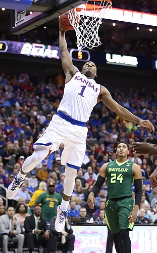 Kansas guard Wayne Selden Jr. (1) comes in for a jam as Baylor guard Ishmail Wainright (24) watches during the first half, Friday, March 11, 2016 at Sprint Center in Kansas City, Mo.