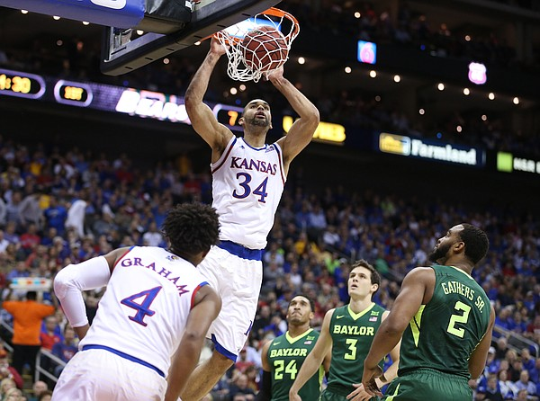 Kansas forward Perry Ellis (34) comes in for a jam off of a lob during the first half, Friday, March 11, 2016 at Sprint Center in Kansas City, Mo.