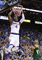 Kansas guard Devonte' Graham (4) delivers on a lob jam before Baylor guard Al Freeman (25) during the first half, Friday, March 11, 2016 at Sprint Center in Kansas City, Mo.