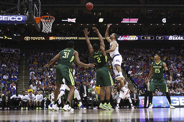 Kansas forward Perry Ellis (34) puts up a floater over Baylor forward Rico Gathers (2) during the first half, Friday, March 11, 2016 at Sprint Center in Kansas City, Mo.