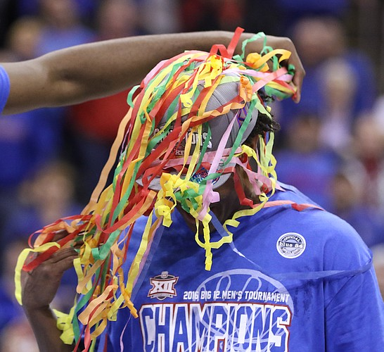 Kansas guard Devonte' Graham has his head wrapped in streamers as the Jayhawks celebrate following their 81-71 win over West Virginia, Saturday, March 12, 2016 at Sprint Center in Kansas City, Mo.