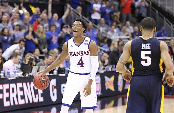 Kansas guard Devonte' Graham (4) flashes a big smile as time runs out in the Jayhawks' 81-71 win over West Virginia, Saturday, March 12, 2016 at Sprint Center in Kansas City, Mo.