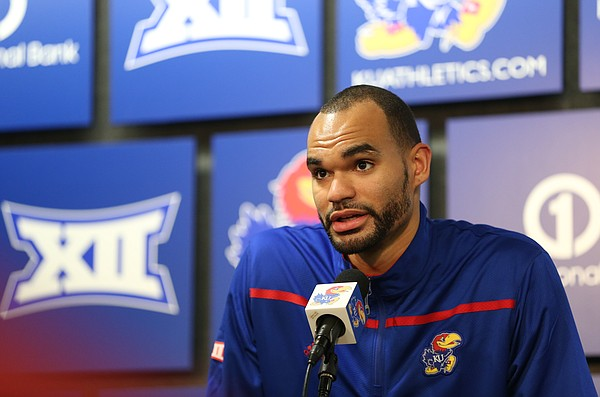 Kansas forward Perry Ellis talks with media members during a news conference following the NCAA Tournament selection show on CBS, Sunday, March 13, 2016 at Allen Fieldhouse on the campus of the University of Kansas in Lawrence, Kan. The Jayhawks were given the No. 1 seed in the South Regional and will play Austin Peay on Thursday in Des Moines.