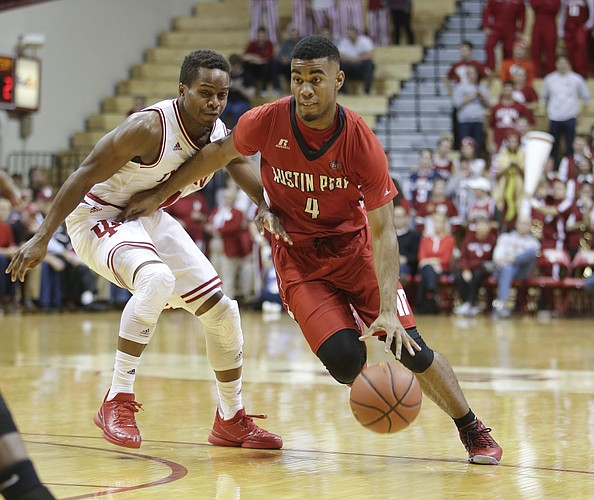 Austin Peay's Josh Robinson (4) is defended by Indiana's Yogi Ferrell (11) during the first half of an NCAA college basketball game Monday, Nov. 16, 2015, in Bloomington, Ind. (AP Photo/Darron Cummings)
