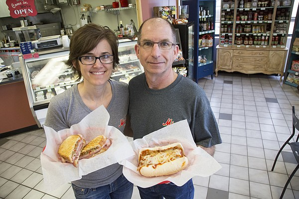 Renee, left, and Jess Maceli, of Lawrence, show off an Italian panini and Polpetto sandwich at their newly opened shop, Miceli's Italian Market and Deli, 3300 W. Sixth St.