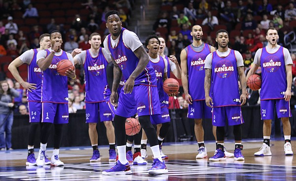 Kansas forward Jamari Traylor (31) and the Jayhawks react after Traylor broke a fixture on the shot clock while  attempting a half-court shot during practice on Wednesday, March 16, 2016 at Wells Fargo Arena in Des Moines, Iowa. The Jayhawks will take on the Governors Thursday.