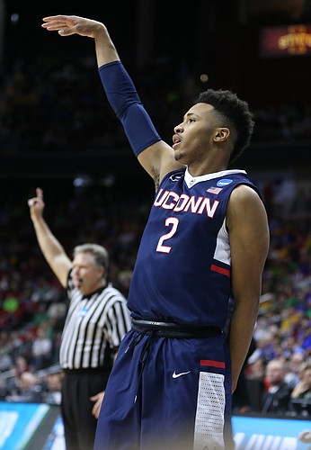 UConn guard Jalen Adams hangs his hand after putting up a shot during the first half, Thursday, March 17, 2016 at Wells Fargo Arena in Des Moines, Iowa.