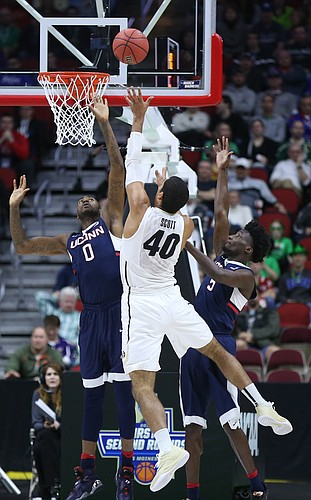 UConn defenders Phillip Nolan (0) and Daniel Hamilton defend against a shot from Colorado forward Josh Scott during the first half, Thursday, March 17, 2016 at Wells Fargo Arena in Des Moines, Iowa.