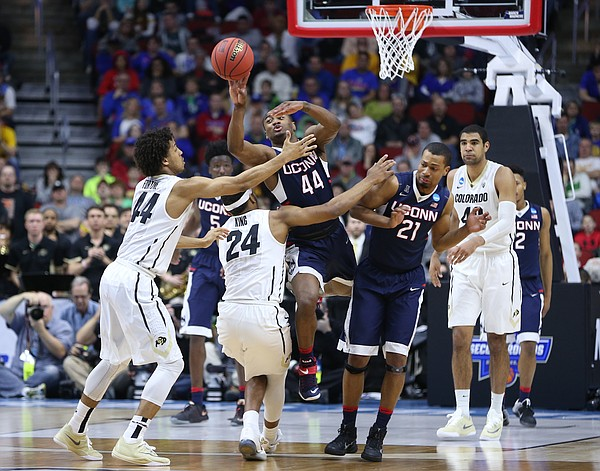 UConn guard Rodney Purvis pushes the ball ahead to break the Colorado press with seconds remaining during the second half, Thursday, March 17, 2016 at Wells Fargo Arena in Des Moines, Iowa.