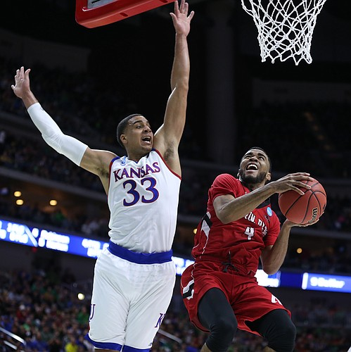 Kansas forward Landen Lucas (33) elevates to defend against a shot from Austin Peay guard Josh Robinson (4) during the first half of a first-round NCAA Tournament game, Thursday, March 17, 2016 at Wells Fargo Arena in Des Moines, Iowa.
