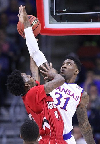 Kansas forward Jamari Traylor (31) gets an arm up to defend against a shot from Austin Peay forward Kenny Jones (42) during the second half, Thursday, March 17, 2016 at Wells Fargo Arena in Des Moines, Iowa.