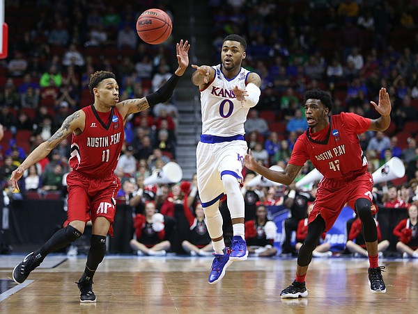 Kansas guard Frank Mason III (0) throws a pass between Austin Peay guard Khalil Davis (11) and forward Kenny Jones (42) during the second half, Thursday, March 17, 2016 at Wells Fargo Arena in Des Moines, Iowa.