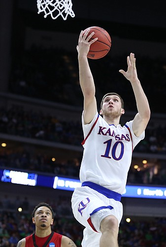 Kansas guard Sviatoslav Mykhailiuk (10) gets to the bucket past Austin Peay guard Khalil Davis during the second half, Thursday, March 17, 2016 at Wells Fargo Arena in Des Moines, Iowa.