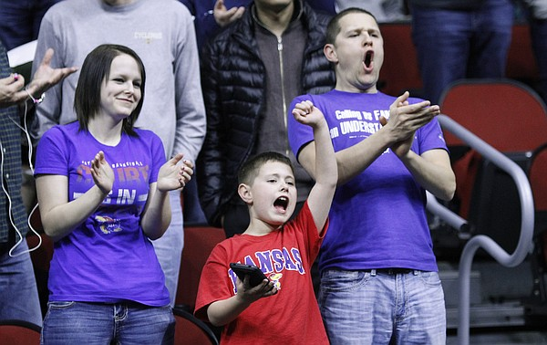 Kansas fans cheer for the Jayhawks as they take the court before a first-round NCAA tournament game against the Austin Peay Governors Thursday, March 17, 2016 at Wells Fargo Arena in Des Moines, IA.