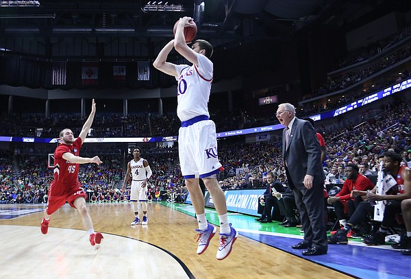 Kansas guard Sviatoslav Mykhailiuk (10)	shoots in a 3-point basket in a first-round NCAA tournament game against the Austin Peay Governors Thursday, March 17, 2016 at Wells Fargo Arena in Des Moines, IA.