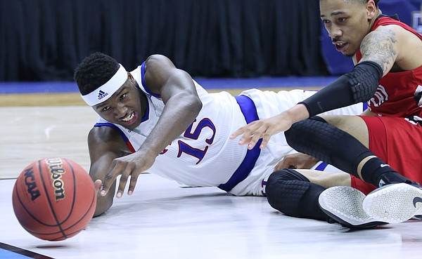 Kansas forward Carlton Bragg Jr. (15) dives for a loose ball in the Jayhawks win against the Austin Peay Governors Thursday, March 17, 2016 at Wells Fargo Arena in Des Moines, IA.