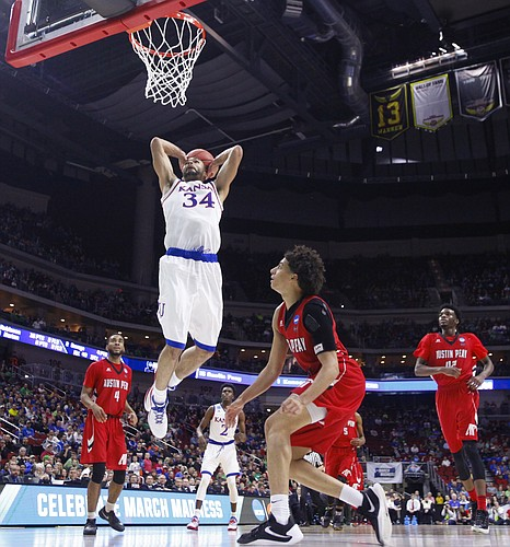 Kansas forward Perry Ellis (34) comes in for a jam against Austin Peay during the second half, Thursday, March 17, 2016 at Wells Fargo Arena in Des Moines, Iowa.