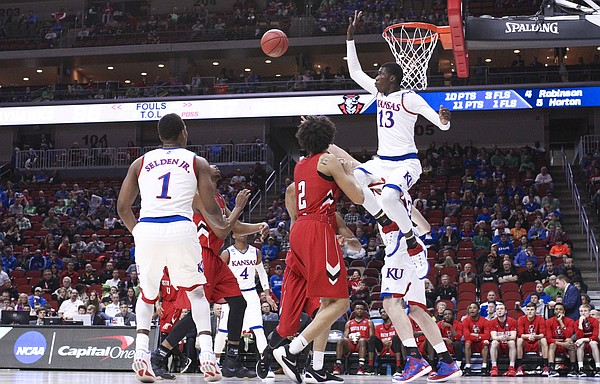 Kansas forward Cheick Diallo (13) gets up to reject a shot during the second half, Thursday, March 17, 2016 at Wells Fargo Arena in Des Moines, Iowa.