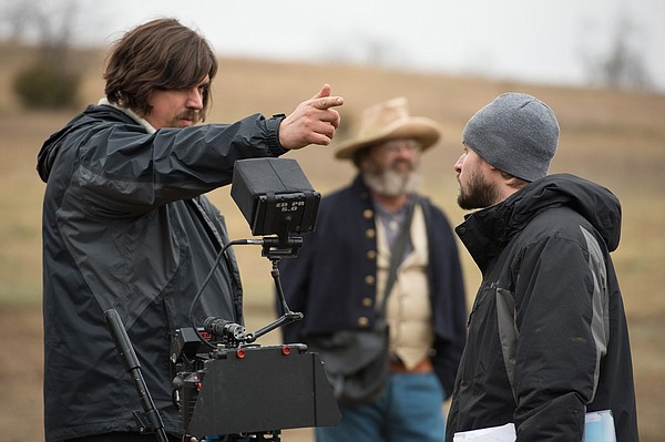 """Red Bird"" co-creator, co-writer and cinematographer Jeremy Osbern, left, talks with producer Chris Blunk during production. The Western web series, which tells the tale of a Bleeding Kansas-era Lawrence mother on a quest to avenge her murdered son, will roll out its first two episodes Thursday."