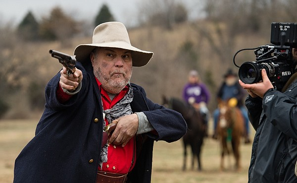"Michael McShane, seen here on the set of ""Red Bird,"" plays Sam, a gunslinger with his own reasons for finding Kitty Mae. The web series, which follows frontier woman Kitty Mae's quest to avenge her murdered son, rolls out its first two episodes Thursday."