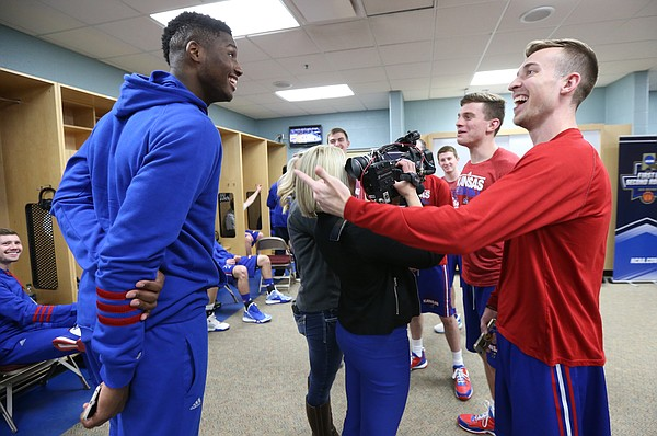 Kansas forward Carlton Bragg Jr. (15) jokes with student manager Chip Kueffer as Kueffer and other student managers are interviewed by media members, Friday, March 18, 2016 at Wells Fargo Arena in Des Moines.