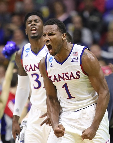 Kansas guard Wayne Selden Jr. (1) and Jamari Traylor celebrate a three from teammate Perry Ellis during the first half against UConn during the first half on Saturday, March 19, 2016 at Wells Fargo Arena in Des Moines.