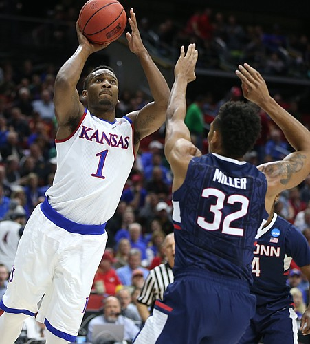 Kansas guard Wayne Selden Jr. (1) leans in for a shot over Connecticut forward Shonn Miller (32) during the first half on Saturday, March 19, 2016 at Wells Fargo Arena in Des Moines.