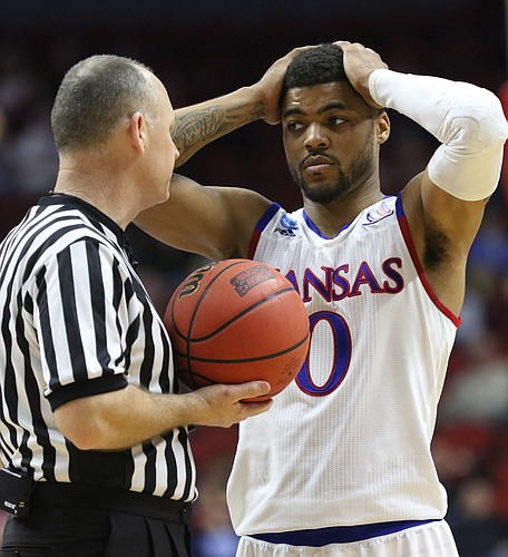 Kansas guard Frank Mason III (0) has a talk with a game official after some chippy play with Connecticut guard Sterling Gibbs during the second half on Saturday, March 19, 2016 at Wells Fargo Arena in Des Moines.