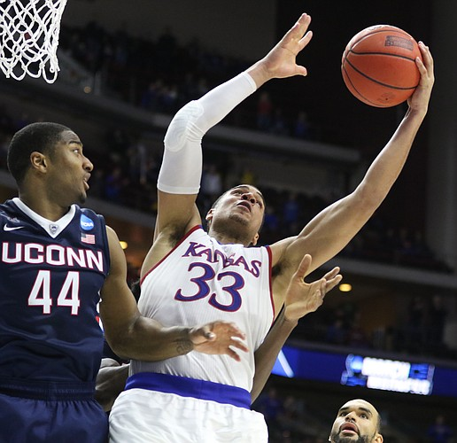 Kansas forward Landen Lucas (33) pulls a rebound from Connecticut guard Rodney Purvis (44) during the second half on Saturday, March 19, 2016 at Wells Fargo Arena in Des Moines.