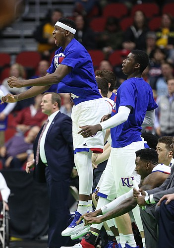 Kansas forwards Carlton Bragg Jr., left, and Cheick Diallo react to a dunk by Wayne Selden Jr. during the second half on Saturday, March 19, 2016 at Wells Fargo Arena in Des Moines.