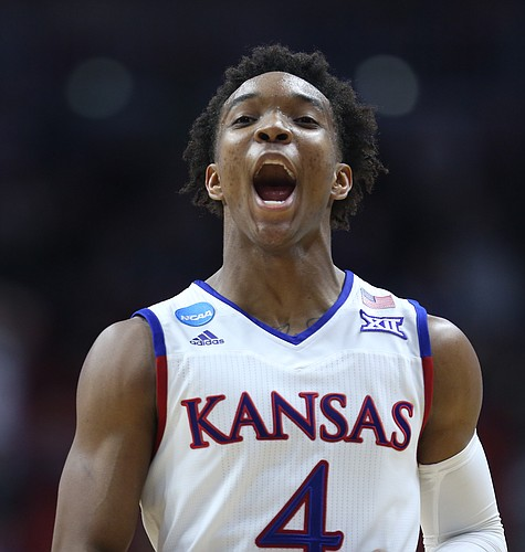 Kansas guard Devonte' Graham (4) celebrates after a dunk by Wayne Selden Jr. during the second half on Saturday, March 19, 2016 at Wells Fargo Arena in Des Moines.