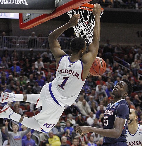 Kansas guard Wayne Selden Jr. (1) puts down a slam dunk in the second-half against the Connecticut Huskies in a 73-61 win at Wells Fargo Arena in Des Moines, IA. Saturday, March 19, 2016.
