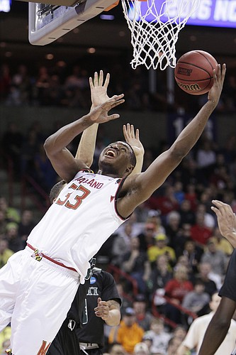 Maryland center Diamond Stone (33) shoots against Hawaii forward Stefan Jankovic during the first half of a second-round men's college basketball game in the NCAA Tournament in Spokane, Wash., Sunday, March 20, 2016. (AP Photo/Young Kwak)