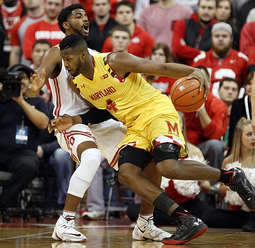 Maryland's Robert Carter, right, drives against Ohio State's JaQuan Lyle during an NCAA college basketball game in Columbus, Ohio, Sunday, Jan. 31, 2016. Maryland won 66-61. (AP Photo/Paul Vernon)
