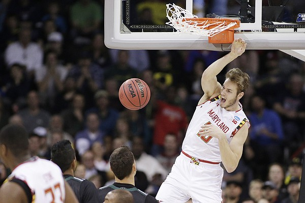 Maryland forward Jake Layman (10) dunks during the second half of a second-round men's college basketball game against Hawaii in the NCAA Tournament in Spokane, Wash., Sunday, March 20, 2016. (AP Photo/Young Kwak)