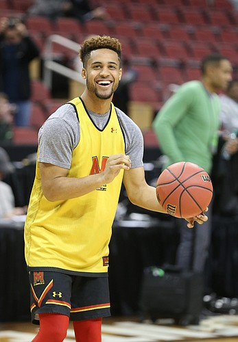 Maryland guard Melo Trimble (2) laughs as he pulls up for a three during practice on Wednesday, March 23, 2016 at KFC Yum! Center in Louisville, Kentucky.