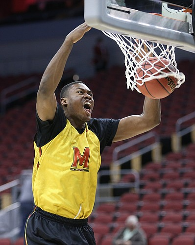 Maryland center Diamond Stone delivers a dunk during practice on Wednesday, March 23, 2016 at KFC Yum! Center in Louisville, Kentucky.