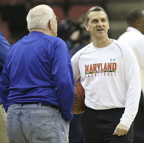 Maryland head coach Mark Turgeon laughs with Kansas radio broadcaster Bob Davis during practice on Wednesday, March 23, 2016 at KFC Yum! Center in Louisville, Kentucky.